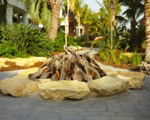 Florida landscape boulders in fire pit area